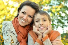 Mother with son in autumn park. Beautiful mother with son in autumn park Royalty Free Stock Photo