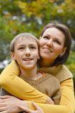 Mother with son in autumn park Stock Photo