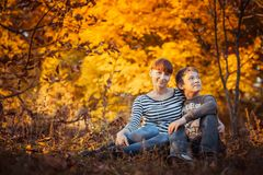 Beautiful mother with son in autumn park Stock Photo