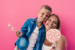 Beautiful mother and son on colored backgrounds. And funny moments stock image