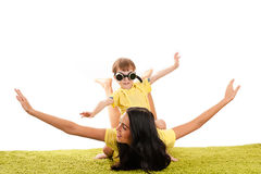 Beautiful mother and son flying Royalty Free Stock Images