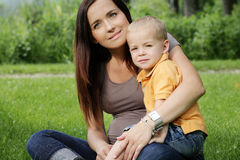Beautiful mother and son in the park. Stock Images