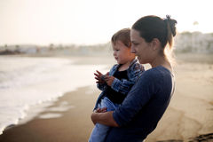 Beautiful mother and son playing on the beach Stock Photo