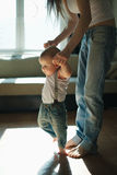 Beautiful mother teaches baby to walk Royalty Free Stock Photos