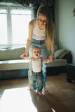 Beautiful mother teaches baby to walk Royalty Free Stock Images