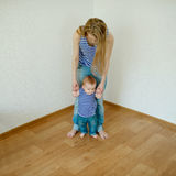 Beautiful mother teaches baby to walk Stock Photography
