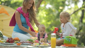 Beautiful mother with two charming little girls stock video footage