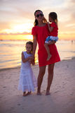 Beautiful mother and two her kids at exotic beach Royalty Free Stock Image