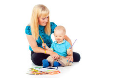Beautiful Mother With A Child Draws Stock Photos