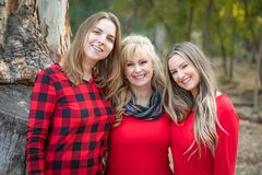 Blonde Mother and Young Adult Daughters Portrait Outdoors. Beautiful Mother and Young Adult Daughters Portrait Outdoors stock images