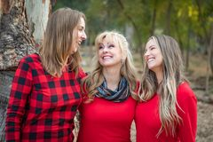 Beautiful Mother and Young Adult Daughters Portrait Outdoors stock images