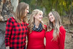 Beautiful Mother and Young Adult Daughters Portrait Outdoors. Beautiful Mother and Her Young Adult Daughters Pose for a Portrait Outdoors royalty free stock photo