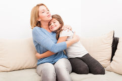 Beautiful mother and young daughter hugging Stock Photos