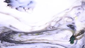 Beautiful motion of liquid paints in milky substance, art concept. Reaction of putting soap drops to the inks in milk.