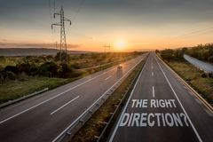 Beautiful Motorway with a Single Car at sunset with motivational message The Right Direction. Beautiful Countryside Motorway with a Single Car at sunset with stock images