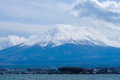Beautiful Mount Fuji with snow capped and blue sky at Lake kawaguchiko, Japan. landmark and popular for attractions stock photography