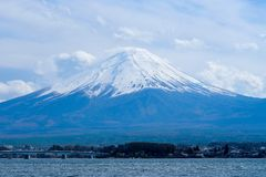 Beautiful Mount Fuji with snow capped and blue sky at Lake kawaguchiko, Japan. landmark and popular for attractions stock image