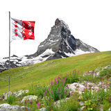Beautiful mount Matterhorn with Valais flag Royalty Free Stock Photo