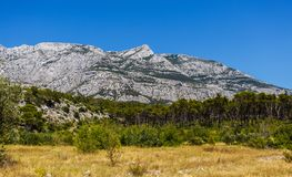 Beautiful mountain Biokovo mountain park in Croatia. Beautiful mountain Biokovo under vibrant blue sky.High rocky mountains in Croatia.Awesome landscape Stock Photo