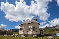 Beautiful mountain church under a sunny blue sky with clouds/Trentino/Dolomites/Italy. /Europe Stock Photography