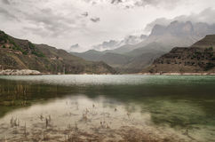 A beautiful mountain lake in the evening in cloudy weather Royalty Free Stock Photography