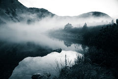 A beautiful mountain lake in a fog in Tatry, Slovakia. Low saturation retro style Stock Image