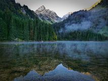 Beautiful mountain lake and forest with reflections. Summer, travel, trip Royalty Free Stock Photos