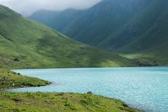 Beautiful mountain lake in Kyrgyzstan. Beautiful mountain lake lake, mountains, trip Royalty Free Stock Photography