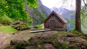 Beautiful mountain lake Obersee with old wooden cottage, Alps, Germany stock video footage