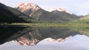 Beautiful Mountain Lake Reflection. A scenic reflection in a Colorado mountain lake stock video