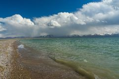 Beautiful lake Son-Kul with blue sky. Beautiful mountain lake Son-Kul, with chic clouds and blue sky Stock Photography