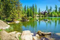 Beautiful mountain lake with stones in foreground Royalty Free Stock Photos