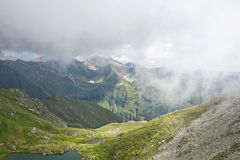 Beautiful mountain lake in summer in Romania. Amazing mountain lake in summer in Romania. Balea lake, the place of tourism Stock Photos