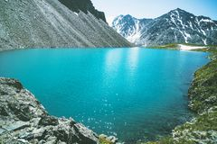 Beautiful mountain lake with turquoise clear water in the Altai Republic Siberia Russia. Pure blue water in a deep lake surrounded Royalty Free Stock Images