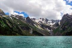 Beautiful mountain lake with turquoise Multinskoe Stock Photo