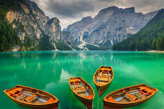 Beautiful mountain lake with wooden boats in the Dolomites,Italy Royalty Free Stock Photos