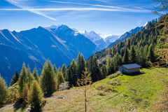 Beautiful mountain landscape. In the Alps with a house on plyane stock images