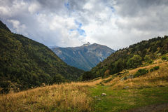 Beautiful mountain landscape in Andorra. Mountain and clouds. Toned Stock Images