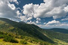 Beautiful mountain landscape. Clouds hid the sun, the shadow of a cloud covered the . Stock Images