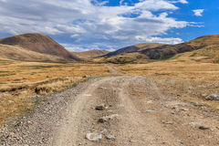 Beautiful mountain landscape with country road and blue sky wiht Stock Image