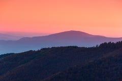 Beautiful mountain landscape at dawn. Beautiful landscape at dawn. Layers of mountain in pink light Stock Photos