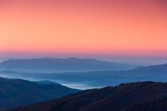 Beautiful mountain landscape at dawn. Beautiful landscape at dawn. Layers of mountain in pink light Stock Image