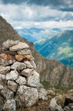 Beautiful mountain landscape with heap of stones and blue sky Royalty Free Stock Photo