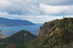 Beautiful mountain landscape. Huge colony of cactuses settled on the mountain slope. Tindari. Sicily Stock Photos