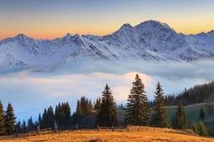Beautiful Mountain Landscape In The Misty Sunrise. Alps, Austria Stock Image
