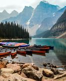Mountain landscape with a lake and canoes royalty free stock photos