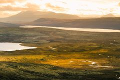 A beautiful mountain landscape with a lake in the distance. Autumn mountains in Norway. Stock Photography