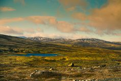 A beautiful mountain landscape with a lake in the distance. Autumn mountains in Norway. Stock Image