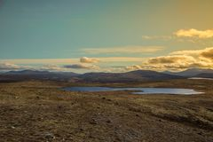 A beautiful mountain landscape with a lake in the distance. Autumn mountains in Norway. Royalty Free Stock Photos