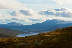 A beautiful mountain landscape with a lake in the distance. Autumn mountains in Norway. Royalty Free Stock Photography